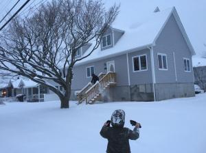 Bryan slides down the snow rails